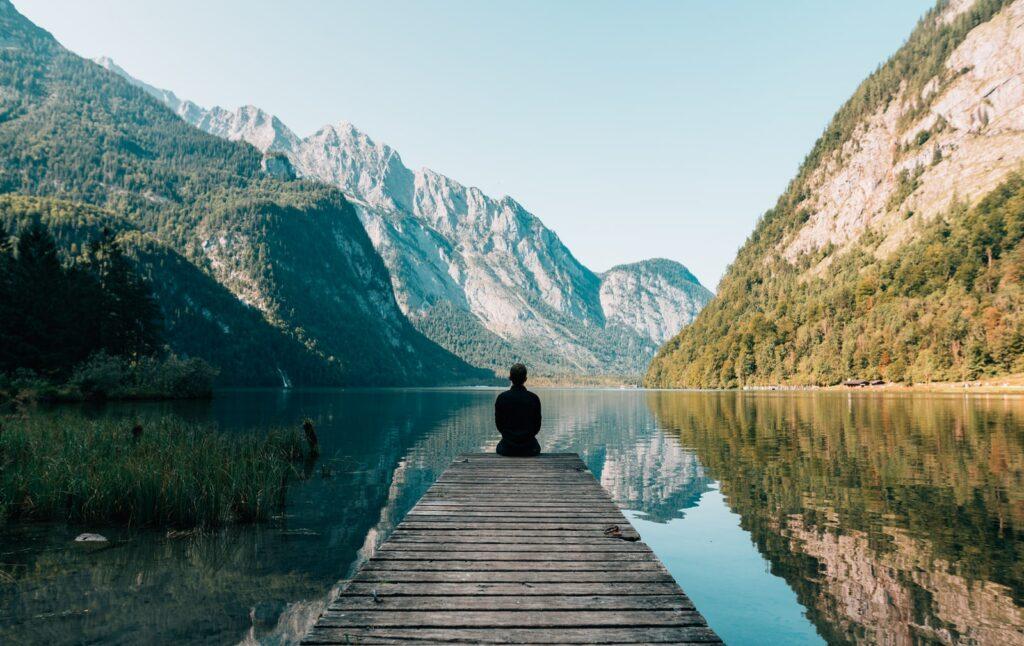 Man sitting front of a lake